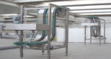 Vertical conveyor for bottles and cans